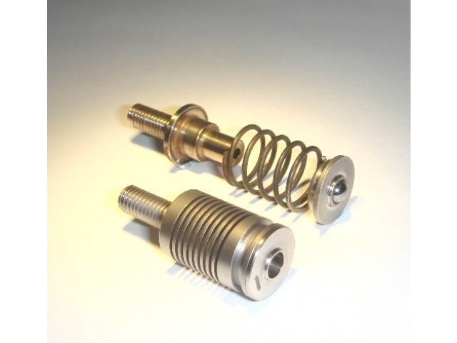Machined spring assimilates separate parts.