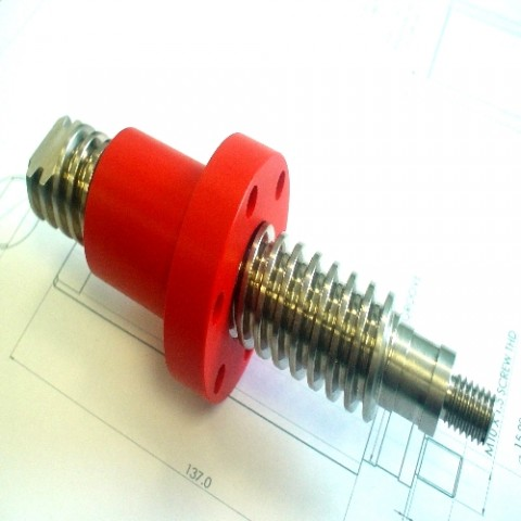 Flanged nut with machined acme lead screw